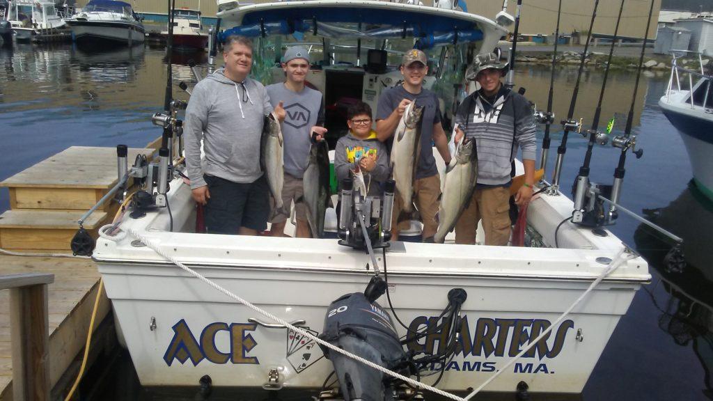 happy crew holding their fish